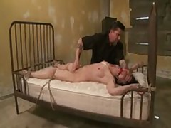 Hogtied submissive being flagellated by master